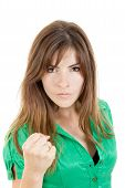 Young Angry Brunette Woman Throwing Punch With Fist To Camera