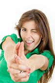Girl In Green Shirt Making Gun Gesture Like Handgun Isolated On White
