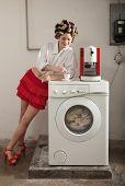 portrait of pretty woman in laundry, interior