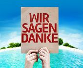 We Say Thank You (In German) card with a beach on background