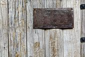 Old Metal Sign On Wood Background
