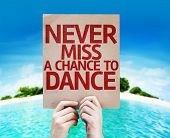 Never Miss a Chance to Dance card with a beach on background