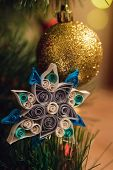 Christmas and New Year decoration shiny golden ball and snowflake