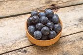 Blackthorn In Wood Bowl On Wooden Background