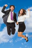 Jumping Business Couple