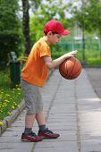 Little Boy Dribbling Basketball Sideview