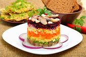 Russian Traditional Herring Salad With Beetroot, Carrot, Eggs On White Pllate. Bread And Cutlets