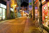 ALBA, ITALY - DECEMBER 05, 2012: Street and shops illuminated for Christmas and New Year holidays. This area is very popular with locals and tourists visiting the town of Alba for holidays.