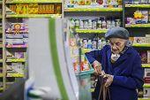 Elderly Womani In A Pharmacy