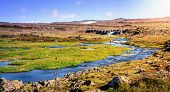 High elevation plateau in Wesfjords, Iceland with a stream and small waterfall