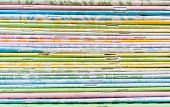 Close-up Of Old Colorful Notebook Spine With Staples