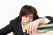 businessman Sleeping on the desk