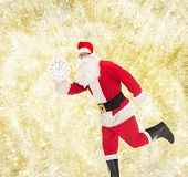 christmas, holidays and people concept - man in costume of santa claus running with clock showing twelve over yellow lights background