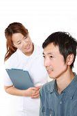 Nurse Talks To Her Patient