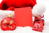 Christmas Santa Claus Cap With Wishes Card In Red On Snow