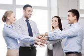 success, business, office and winning concept - happy business team celebrating victory in office