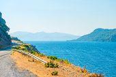 Meandering Mountain Highway Runs Along The Sea