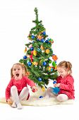 foto of twin baby girls  - Twin girls are enjoying the Christmas Tree isolated on white Background - JPG