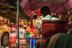 stock photo of crippled  - traffic jam seen from inside a Tuk Tuk in the very heart of the city which is world famous for chronic and crippling traffic congestion - JPG