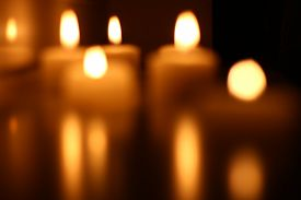 stock photo of funeral  - Holiday candles burning on a white background and reflected - JPG