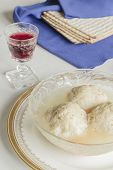 picture of passover  - Traditional passover matzoh ball soup with unleavened bread and wine - JPG
