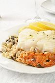 picture of cod  - Cod Provencal on wild rice with slices of lemon - JPG