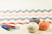 foto of knitting  - rolls of soft knitting yarn knitting on white background - JPG