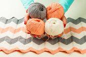 image of knitting  - rolls of soft knitting yarn knitting female hands on white background - JPG