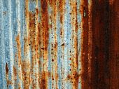 A rusty corrugated iron metal fence close up/ Zinc wall