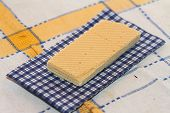 stock photo of section  - wafer and napkin in a section on a cloth in a section