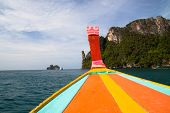 image of phi phi  - Detail of long tail boat and beautiful scenic coastline of Phi Phi Island in Thailand - JPG
