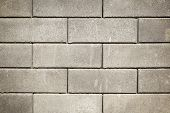picture of stockade  - Lots of gray bricks laid tiles for a wall - JPG