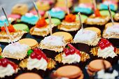 stock photo of sweet food  - catering services background with sweet snacks and food in restaurant - JPG