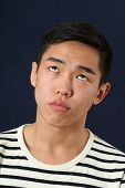 pic of turn-up  - Funny young Asian man making face and rolling eyes up - JPG