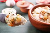 picture of fried onion  - Fried dumplings with onion and bacon in frying pan - JPG