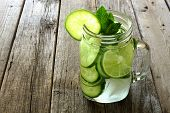 foto of masonic  - Detox water with lime and cucumbers in a mason jar against a rustic wood background - JPG