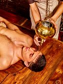 stock photo of ayurveda  - Young man having Ayurveda spa treatment - JPG