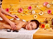 image of stone-therapy  - Woman getting stone therapy massage in wooden spa - JPG