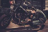 picture of carburetor  - Biker repairing his custom motorcycle bobber on a road  - JPG