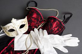 image of fetish clothes  - sexy female lingerie mask and gloves on grey background - JPG