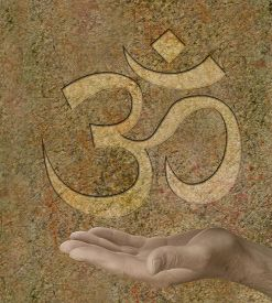 picture of om  - Om symbol engraved on stone effect background with a male hand outstretched palm facing up - JPG