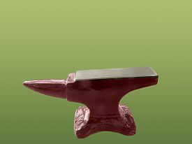stock photo of anvil  - Iron red anvil isolated on green background - JPG