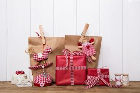 picture of christmas angel  - Christmas presents wrapped in paper bags with red white checked ribbon - JPG