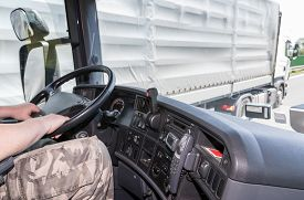 image of trucks  - View from the truck cab for the driver who holds the steering wheel - JPG
