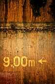 Yellow numbers on a rusty metal background