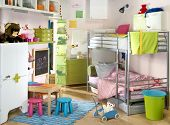 stock photo of bunk-bed  - light children room with many toys - JPG