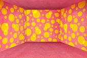 funny cardboard room of pink color and yellow circles