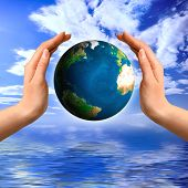 Earth globe in hands Environment and ecology concept