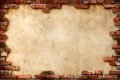 Grungy parchment paper background surrounded by red brick frame isolated with clipping path