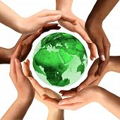 Conceptual symbol of a green Earth globe with multiracial human hands around it. Isolated on white b